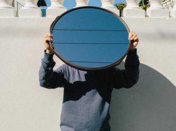 yesheis-image-holding-mirror.jpg