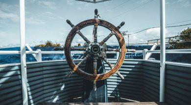boat-steering-wheel-joseph-barrient-unsplash.jpg