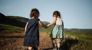 girls-holding-hands-josue-michel-unsplash.jpg