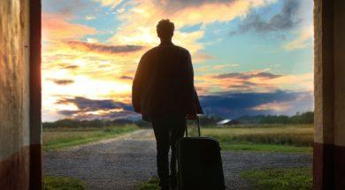 man-suitcase-mantas-hesthaven-unsplash.jpg