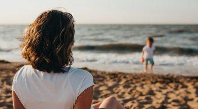 mum-and-son-beach-xavier-mouton-unsplash.jpg