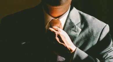man-adjusting-tie-ben-rosett-unsplash.jpg