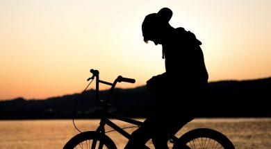 silhouettte-boy-bike-tim-graf-unsplash-.jpg